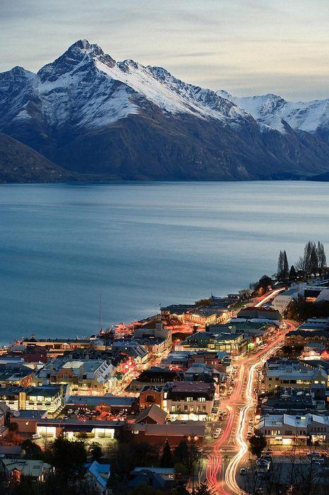 city lake mountain ligts street snow