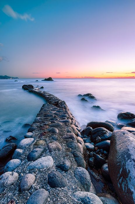 sunset water ocean stones wallpaper