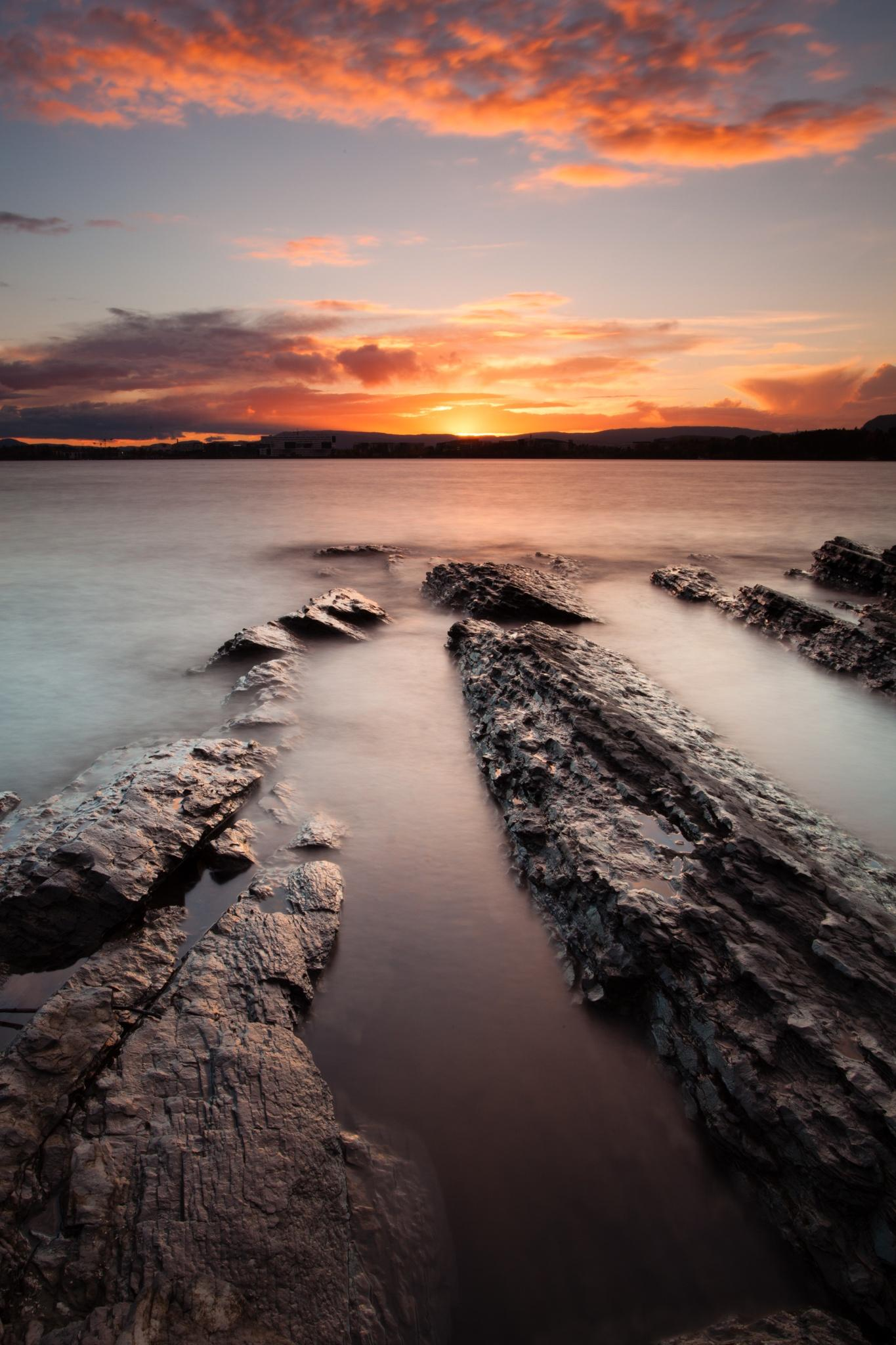 sunset stone clouds ocean wallpaper