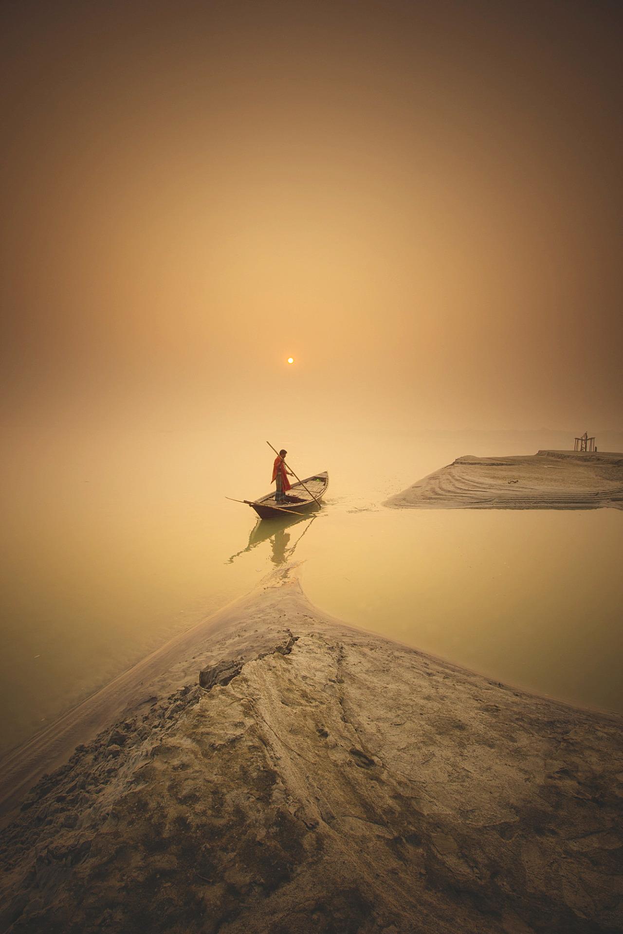 fog lake man boat 1280x1920