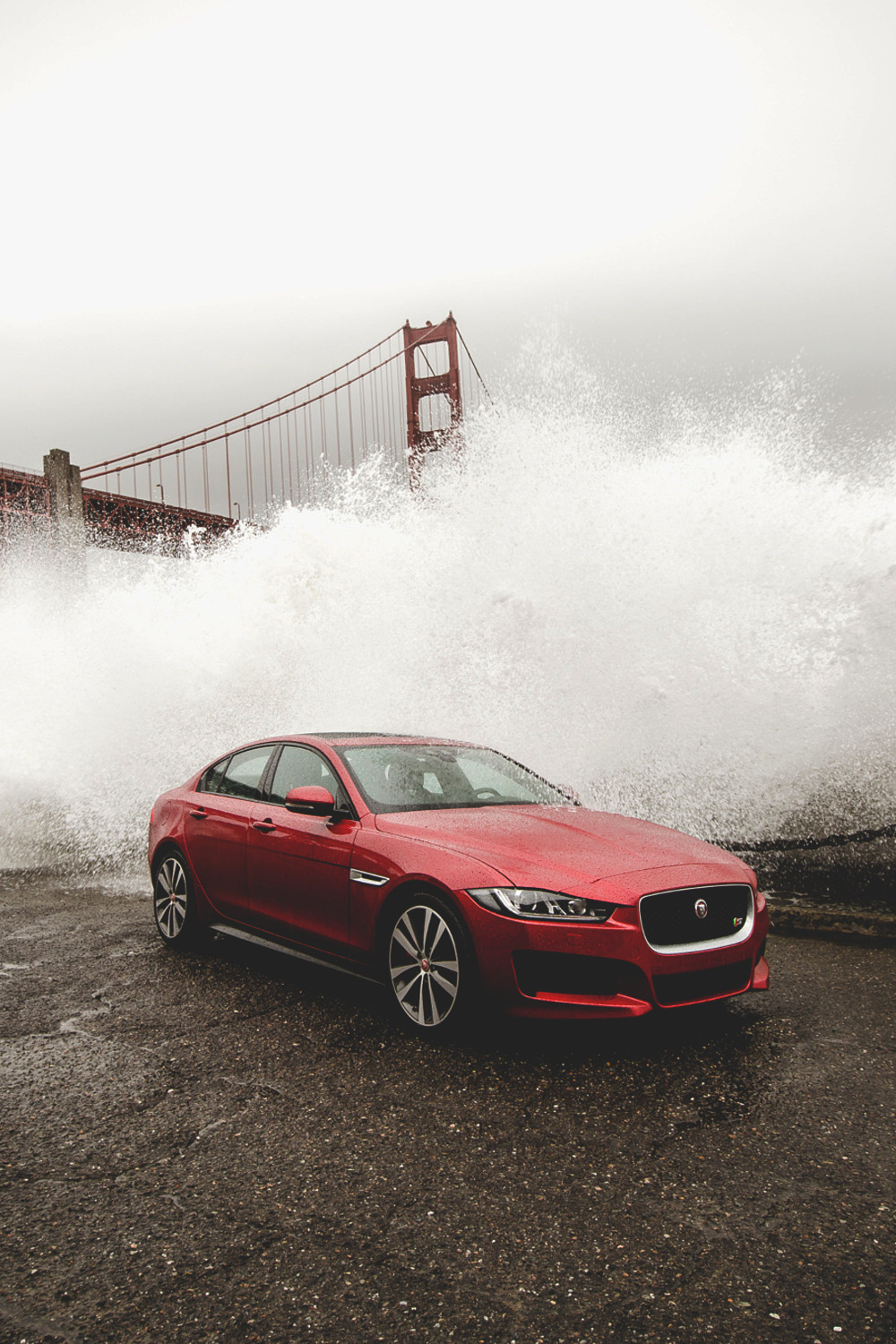 jaguar red sportcar bridge golden gate water drops