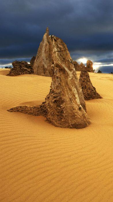 desert stones shote sand dark sky