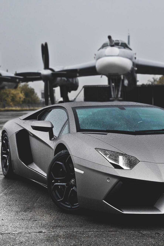 lamborghini aventador grey rain plane