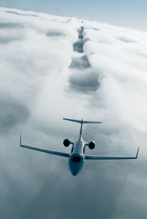 business jet clouds