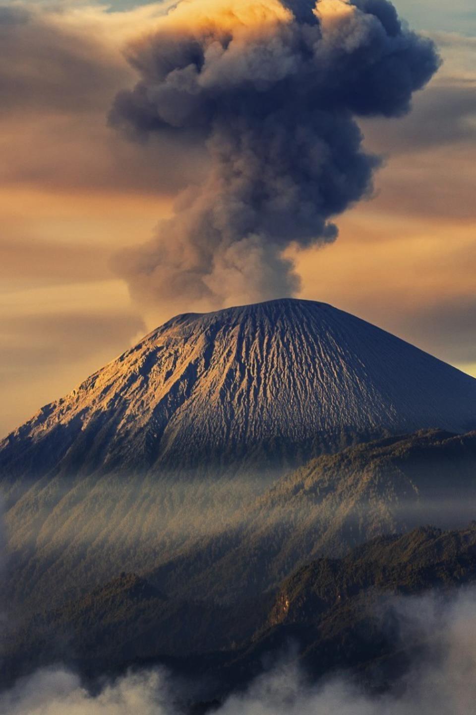 mountains smoke volcano sky