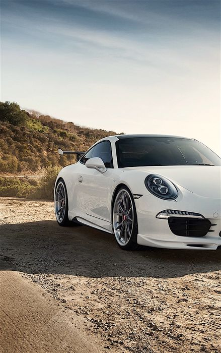 porsche 911 white sportscar mountain road sky
