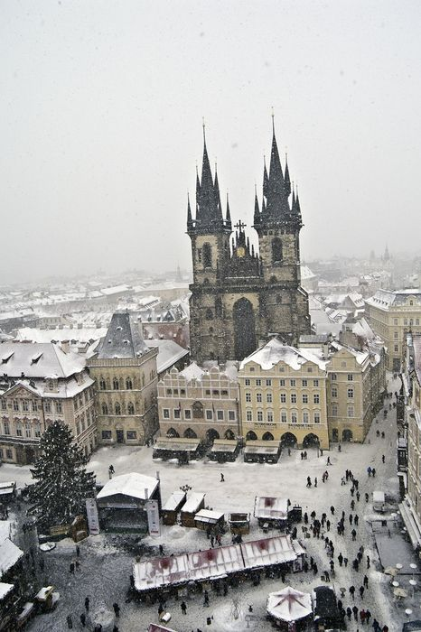 prague winter snow church architecture cathedral city religion tourism tower travel