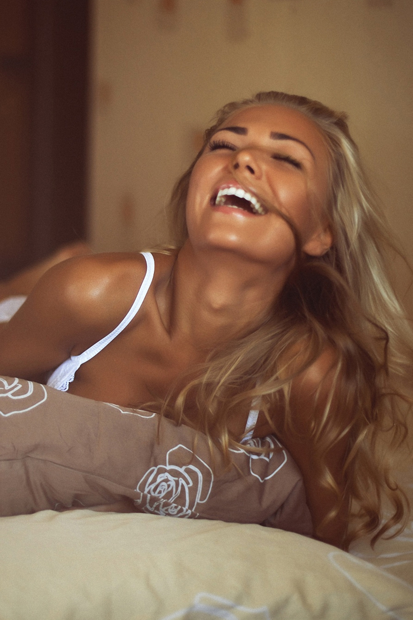 adorable girl bed laughing blonde