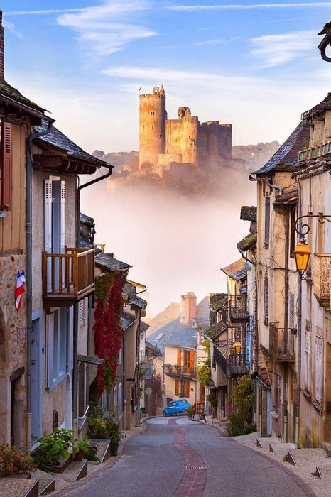 chateau de najac france castle fog houses