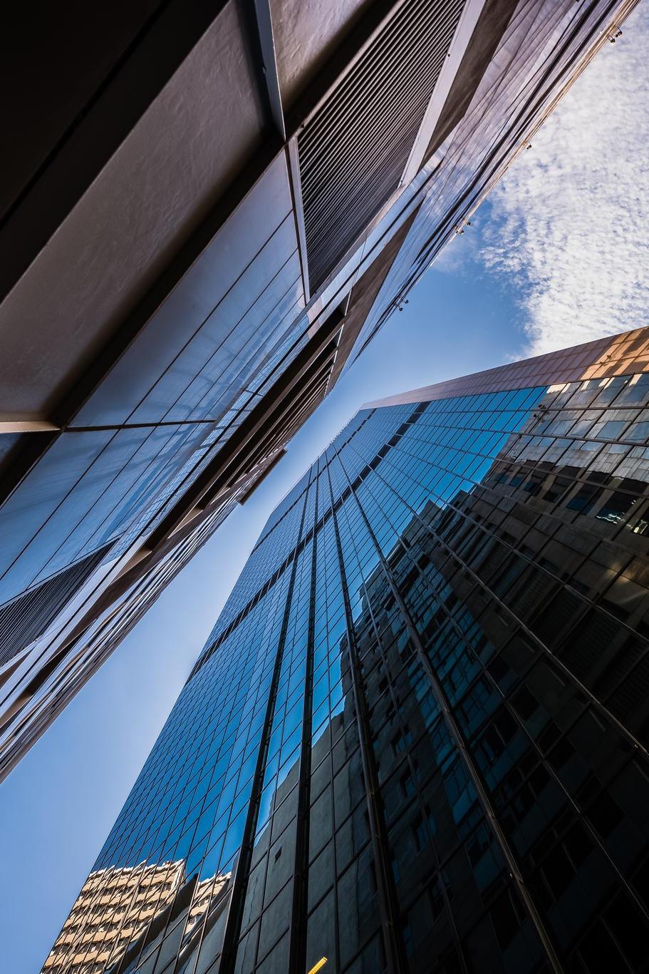 between skyscrapers glass bottom view sky