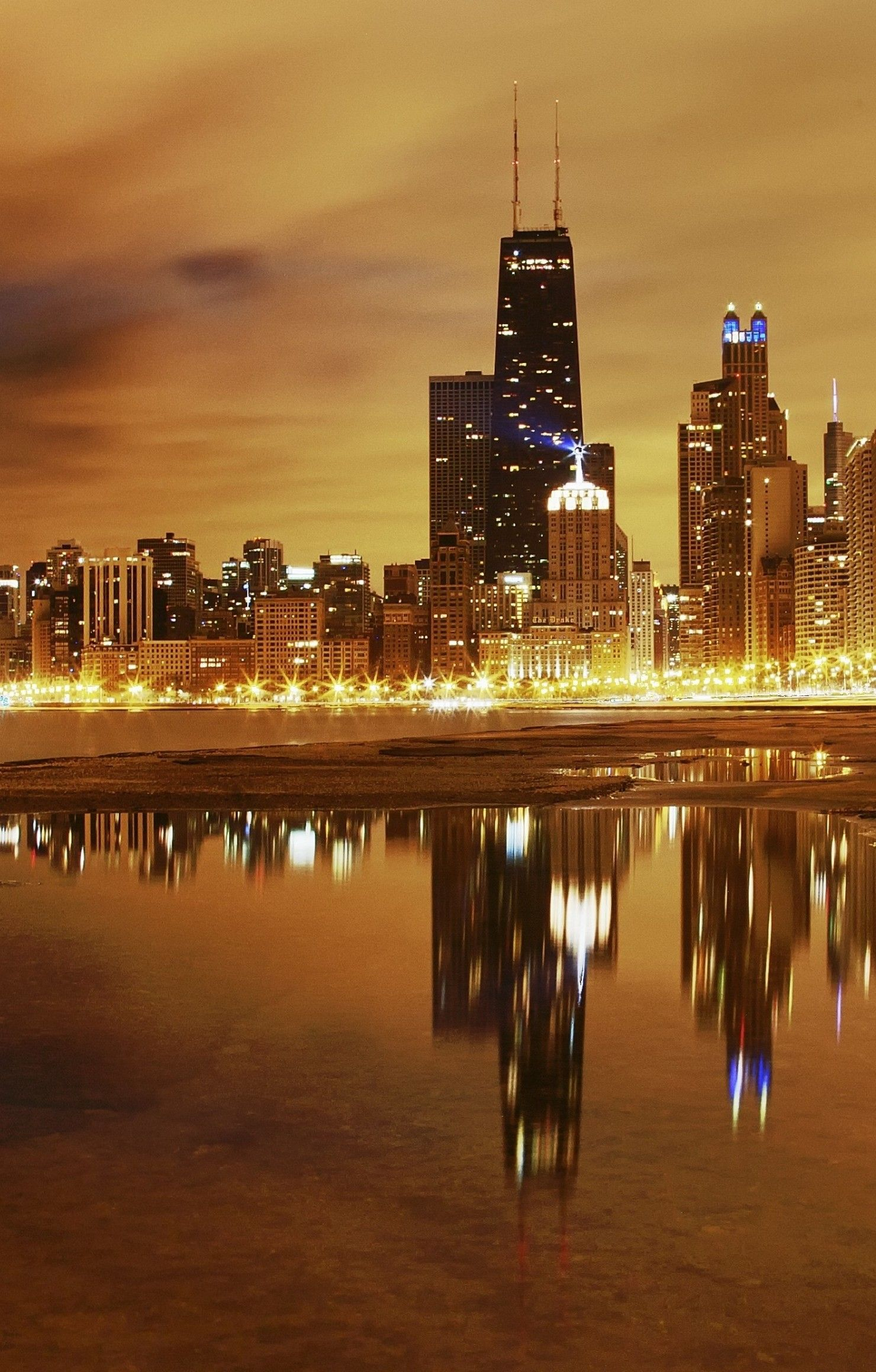 city chicago skyscrapers night lights lake reflection retina