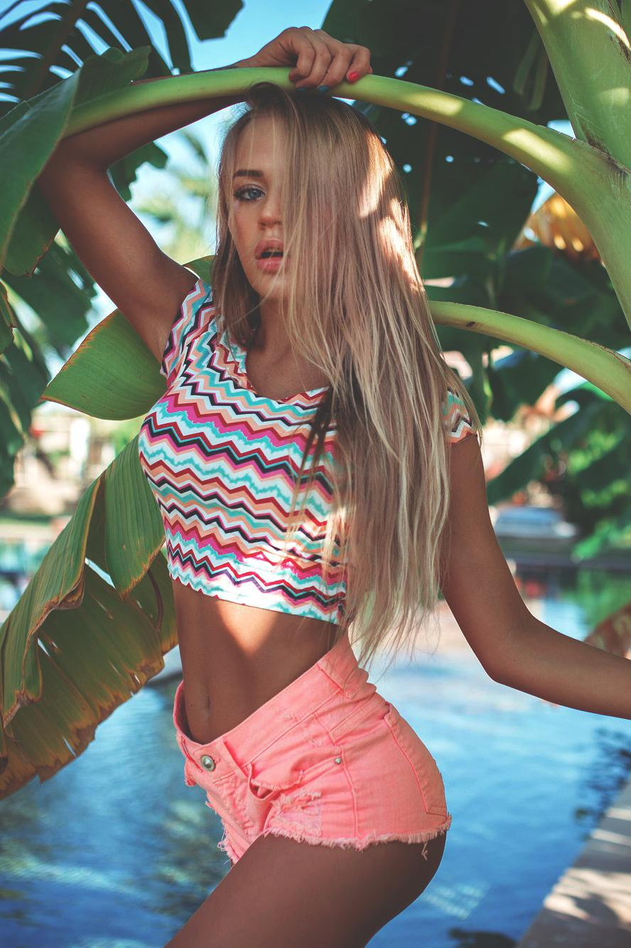 lovely girl pink shorts palm blonde