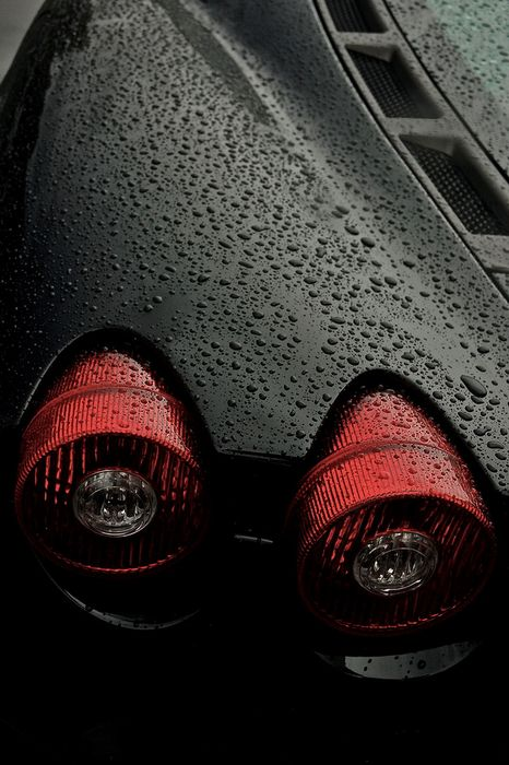 black ferrari supercar drops macro
