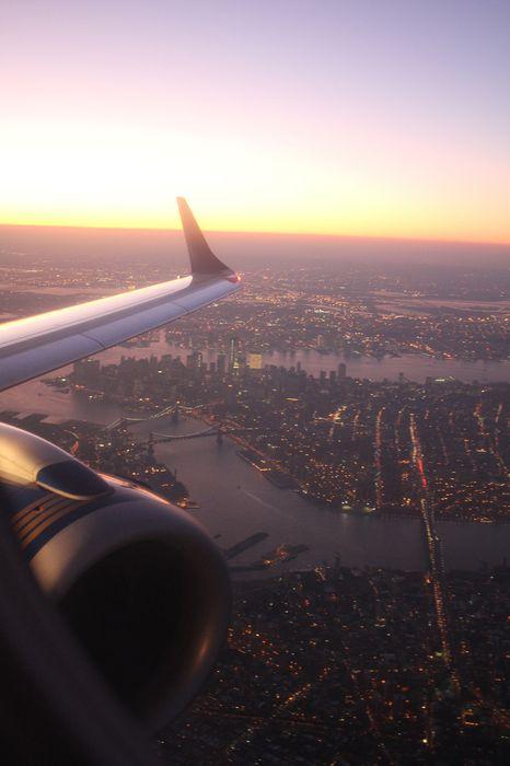 airplane window megalopolis lights