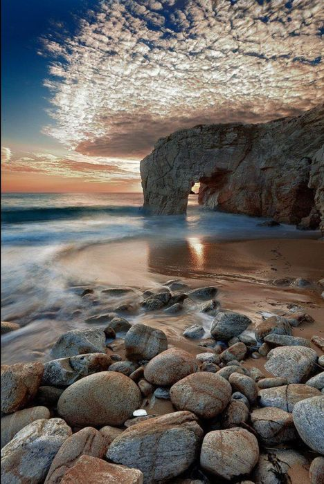 arch ocean stones clouds sky wallpaper
