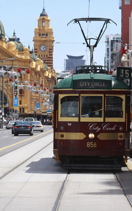 tram street sun clock cars city circle