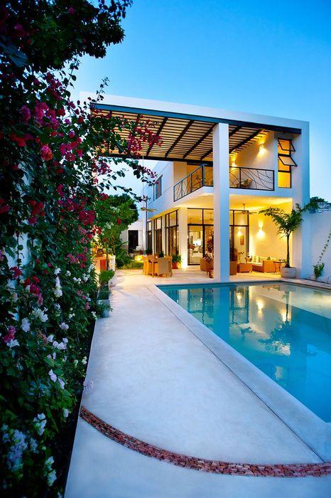 luxury white house swimming pool flowers