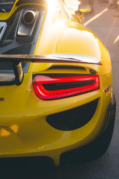 porsche 918 sportcar yellow macro 1280x1920