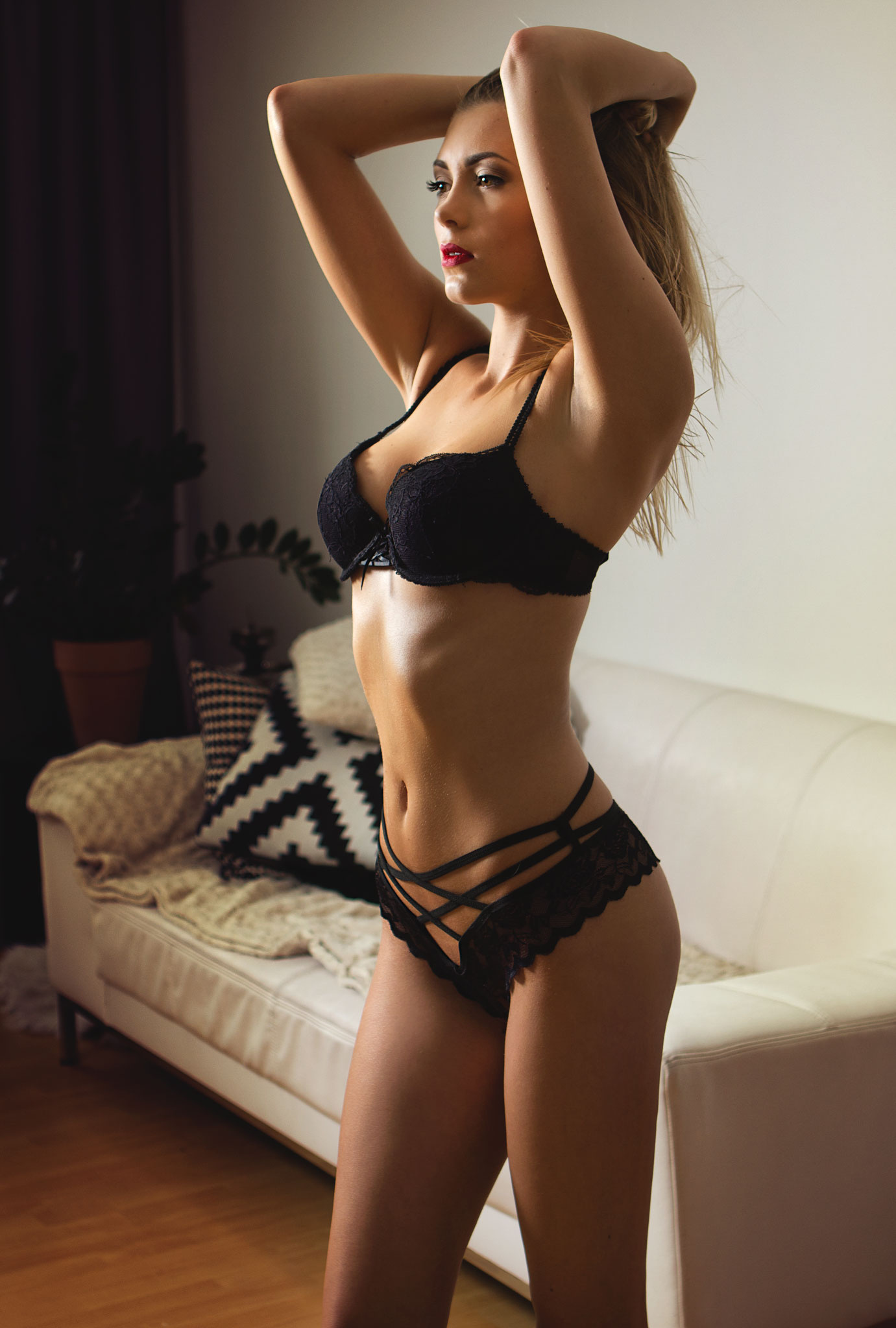 model girl in black lingerie room