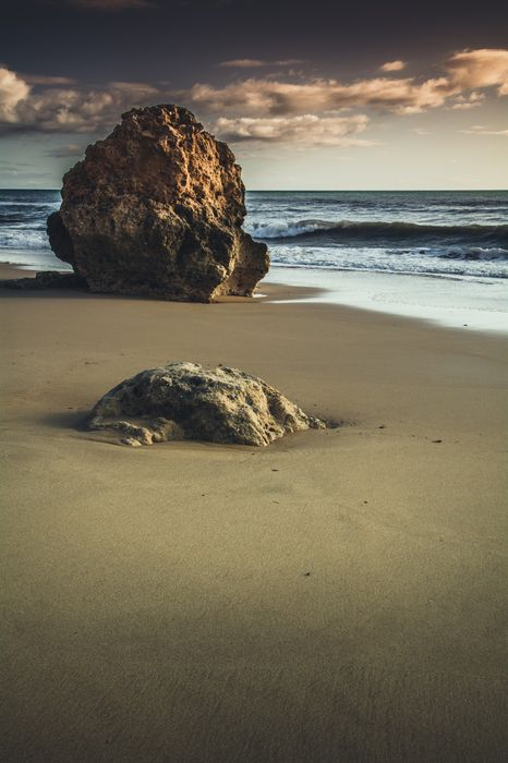 sand beach stone ocean 1280x1920