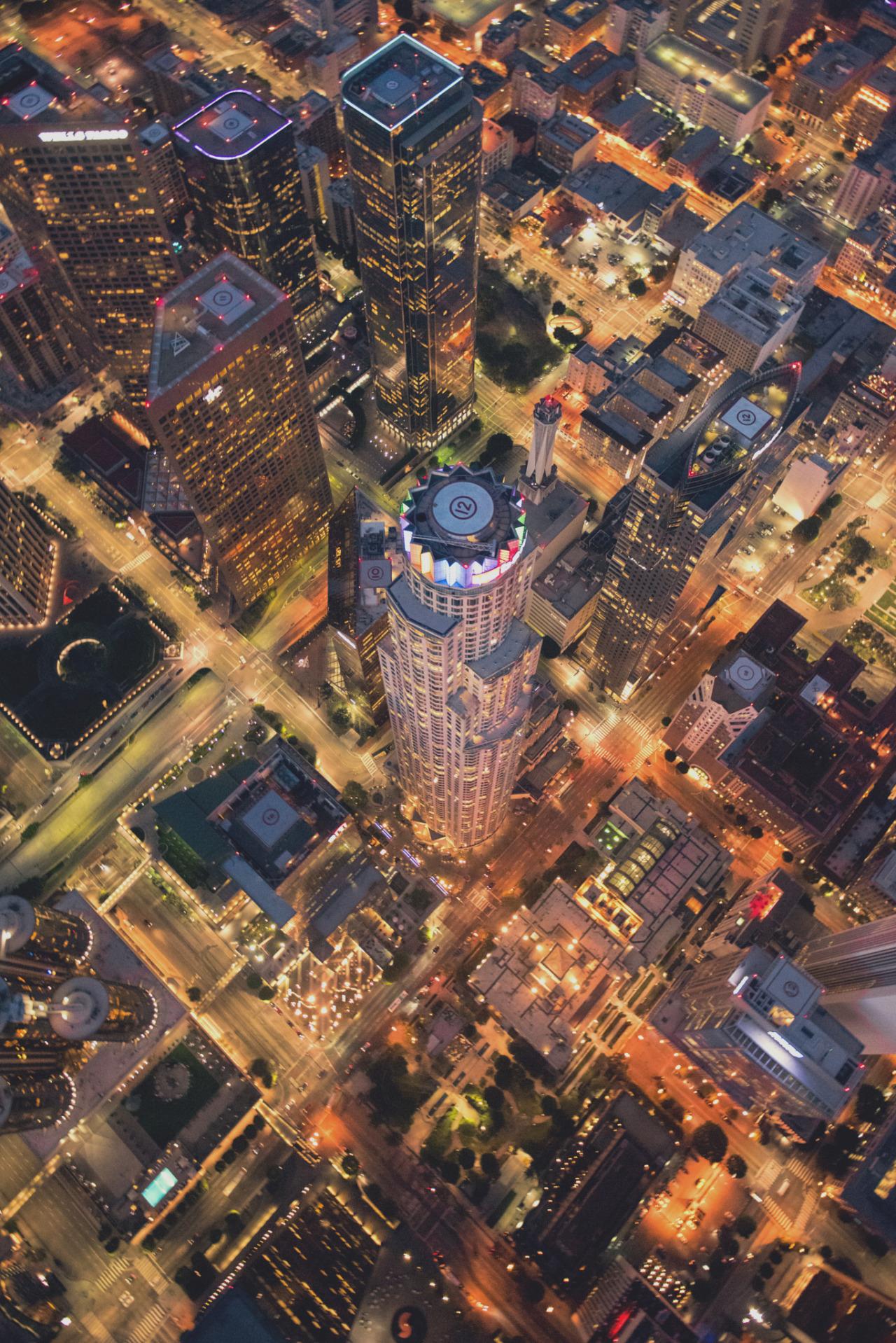 city skyscraper lights night urban fly top view