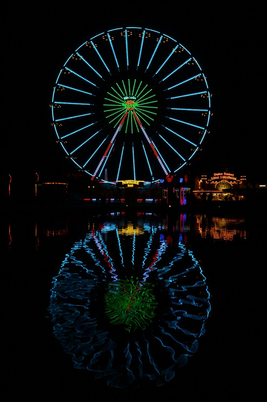 big wheel lights water reflection park night