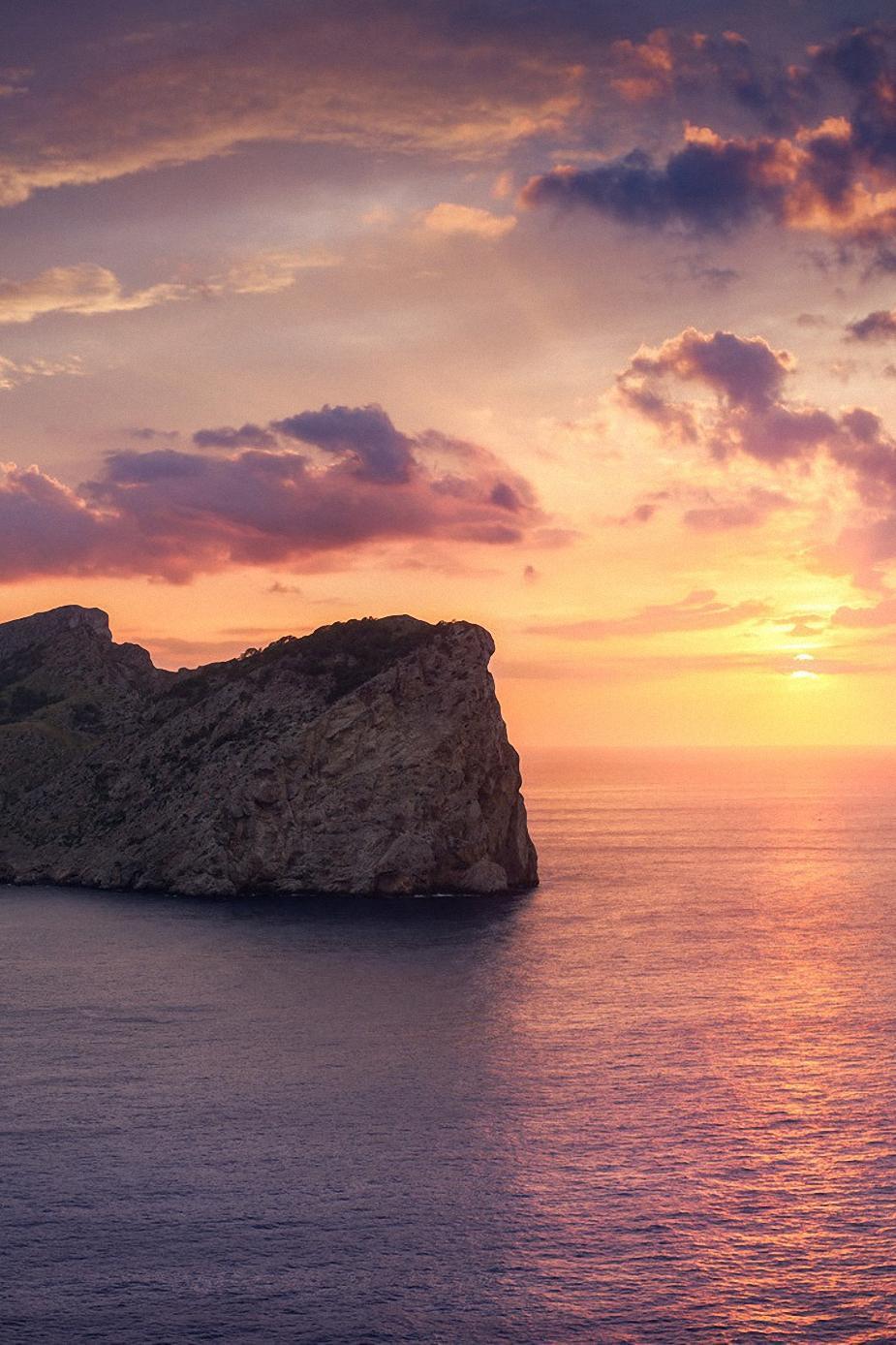 ocean rock sunset clouds