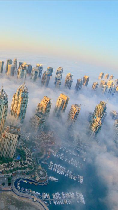 dubai city fog skyscrapers 1080x1920