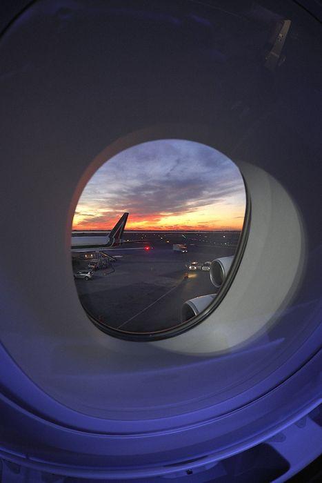 plane window airport sunset