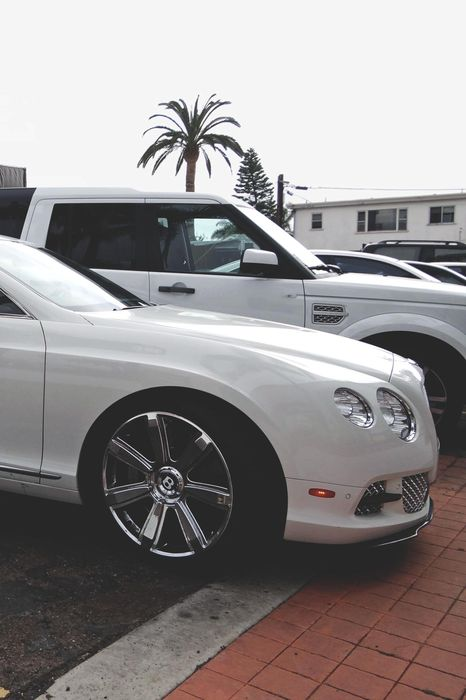 white bentley parking street 1280x1920