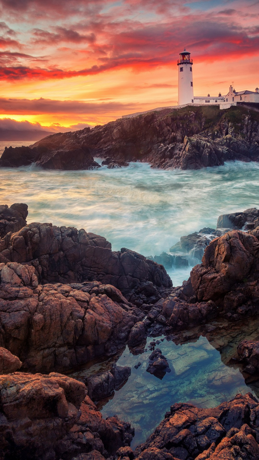 lighthouse sunset ocean stones 1080x1920
