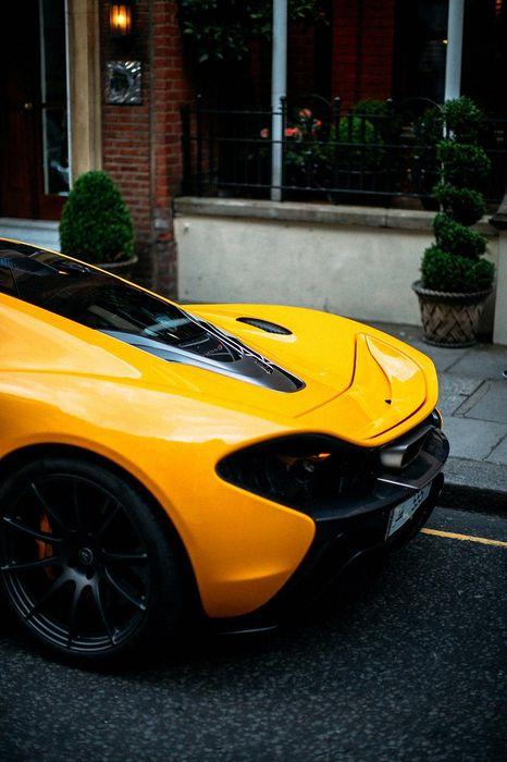 mclaren p1 yellow back street