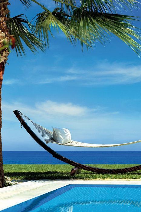 blue sky ocean relax hammock
