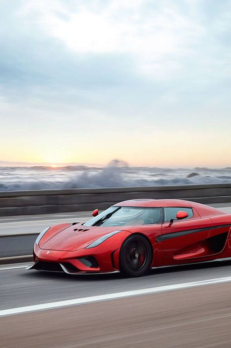 candy red koenigsegg regera sportscar speed ocean