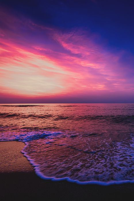 violet beach sea water landscape ocean sky sunset coast clouds travel