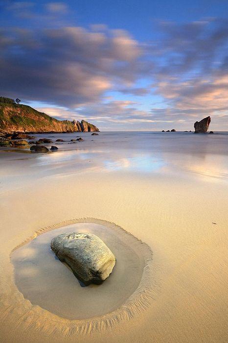 beach stone sand amazing sky
