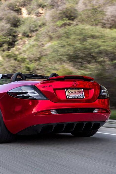 mercedes red sportscar speed back view road
