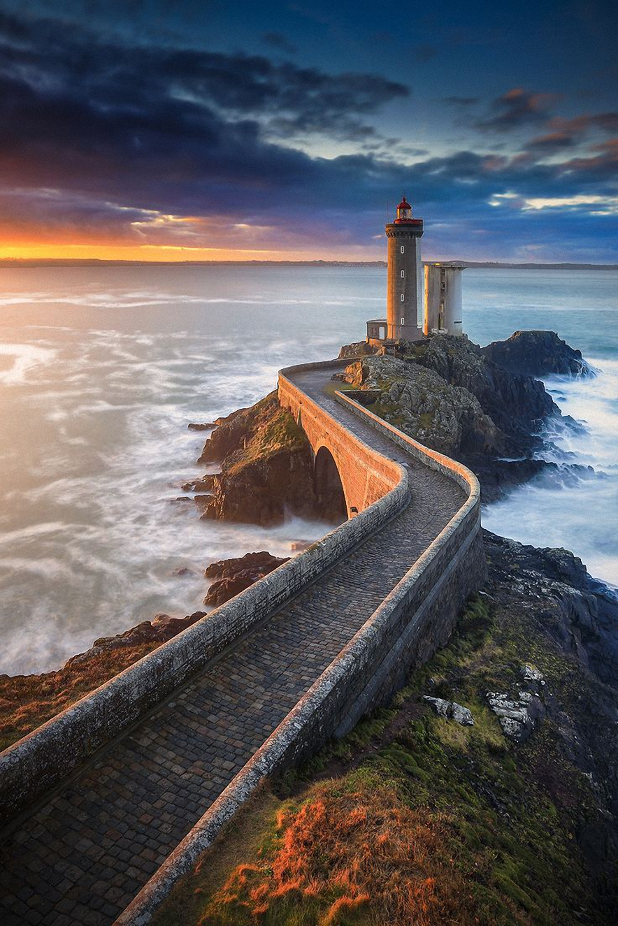 lighthouse ocean stones sunset waves road