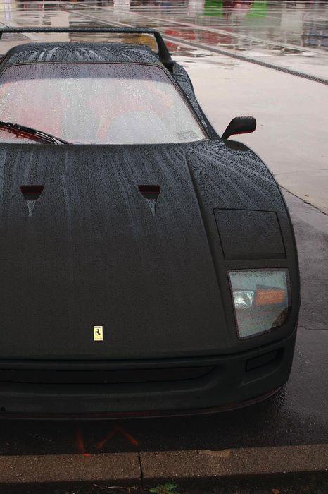 ferrari f40 black sportscar rain drops track