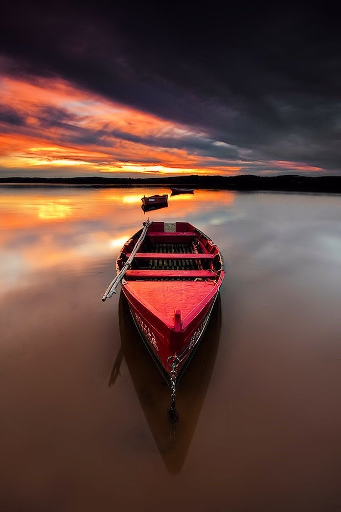 beach red boat sunset