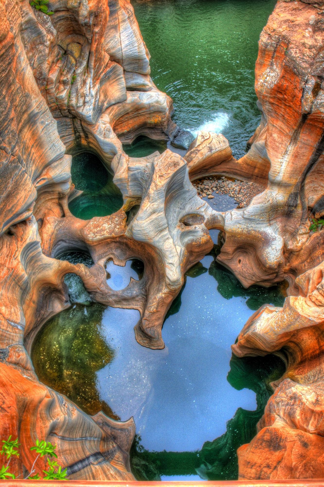 lake water green orange stones nature