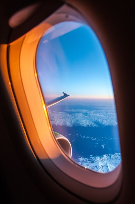 flight plane window clound topview mountains