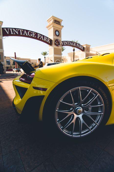 porsche 918 spyder sportcar yellow back vintage park 1280x1920