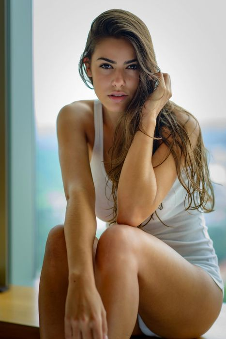 pretty girl in white shirt window