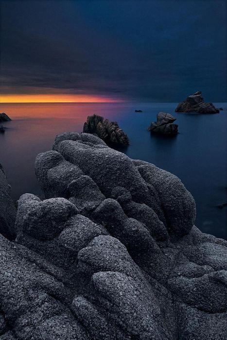 stone sunset dark sky clouds