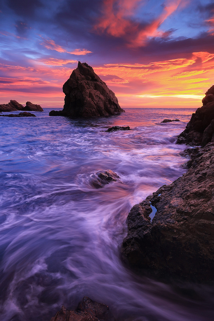 sunset violet water stone