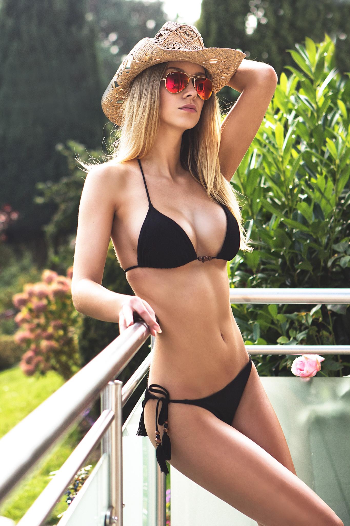 black swimsuit girl adorable sun glasses hay balcony
