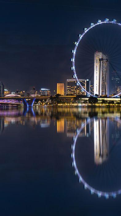 bigwheel waterfront reflection city marina skyline building architecture night