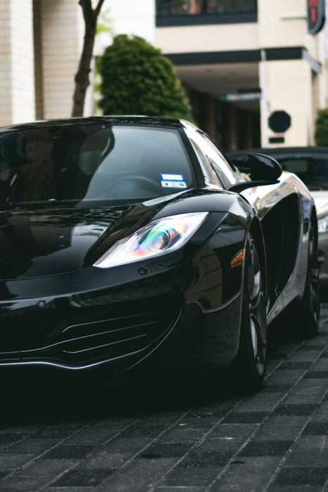 black mclaren 12c sportscar building street luxury speed