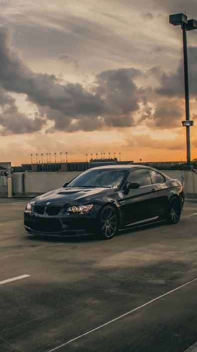 bmw m3 black roof building parking sportscar sunset